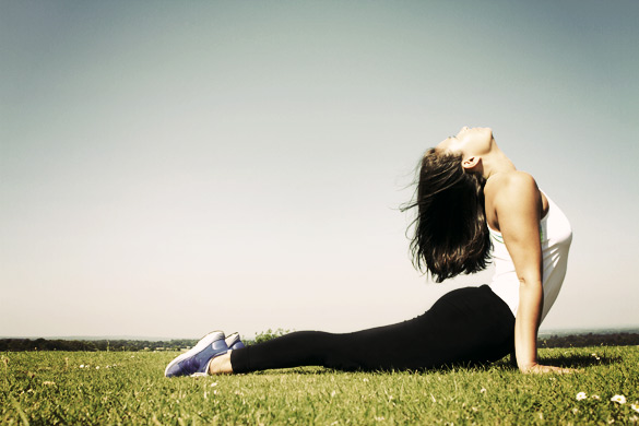 Young woman doing a Yoga Pose and Stretch
